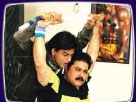 Movie Still From The Film Phir Bhi Dil Hai Hindustani Featuring Shahrukh Khan,Satish Shah
