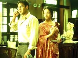Movie Still From The Film Raincoat Featuring Ajay Devgan,Anu Kapoor