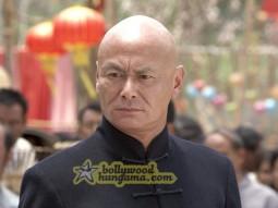 Movie Still From The Film Chni Chowk To China Featuring Gordon Liu