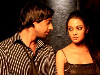 Movie Still From The Film A Strange Love Story,Eddie Seth,Riya Sen