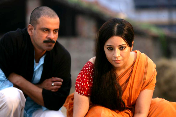 Movie Still From The Film Gangs Of Wasseypur,Manoj Bajpayee,Reema Sen