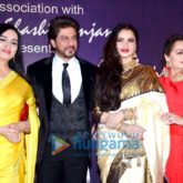 Rekha presents Shah Rukh Khan with the 4th Yash Chopra Memorial award