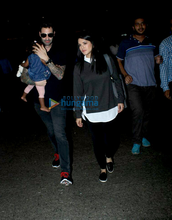 Sunny Leone, Daniel Weber snapped with kid Nisha Kaur Weber at the airport