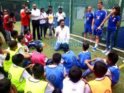 Spotted Abhishek Bachchan teaches football to kids