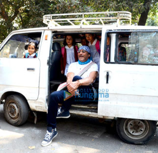 Jackie Shroff poses with school children in Bandra