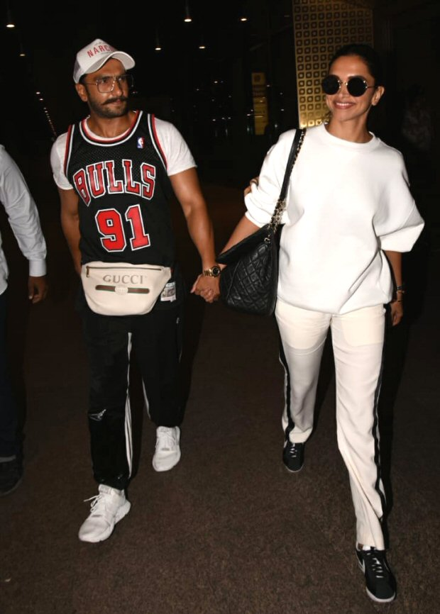 Lovebirds Ranveer Singh and Deepika Padukone are holding hands and are all smiles as they return from their vacay